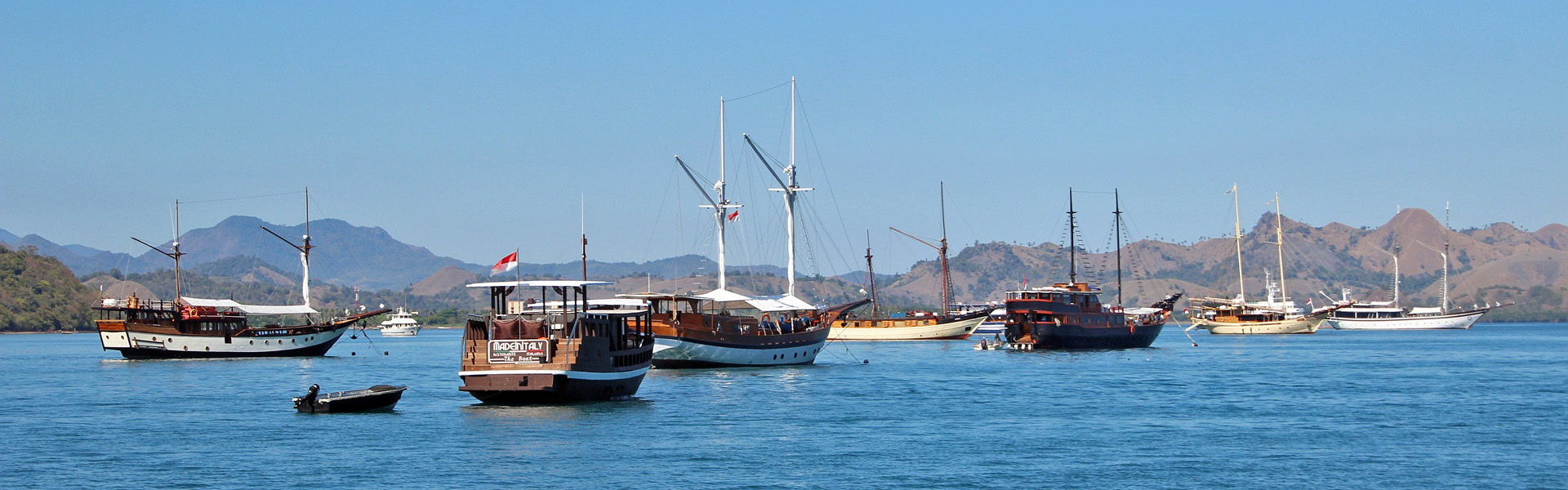 Liveaboard dive boats at anchor in Labuan Bajo Harbour, Komodo Islands